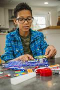 Boy working on science project at home - stock photo