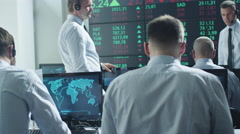 Group of Stockbrockers Actively Working at Stock Exchange Stock Footage