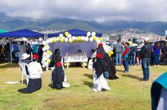 QUITO, ECUADOR - JULY 7, 2015: Nuns praying for pope Francisco, little altar in - stock photo