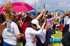 QUITO, ECUADOR - JULY 7, 2015: People raising her hands to receive pope - stock photo