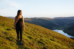 Young woman strolling, Talybont Reservoir in Glyn Collwn valley, Brecon Beacons, Stock Photos
