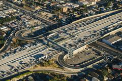 Aerial view of traffic and slip roads on multi lane highway, Los Angeles, - stock photo
