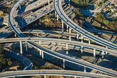 Aerial view of traffic on multi lane highways and flyovers, Los Angeles, - stock photo