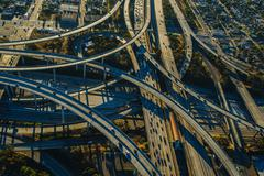 Aerial view of curved flyovers and multi lane highways, Los Angeles, California, - stock photo