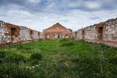 Dilapidated stud farm - stock photo