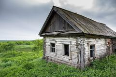 Dilapidated old village house in Russia - stock photo
