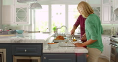 Couple Make Roast Turkey Meal In Kitchen Shot On R3D Stock Footage