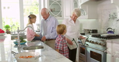 Children And Grandparents Make Roast Turkey Meal Shot On R3D Stock Footage