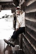 Mid adult woman by chalet, portrait - stock photo