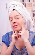 Clean face after shower, little massage with fingers. Young woman Stock Photos