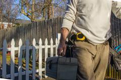 Handyman going to house call Stock Photos
