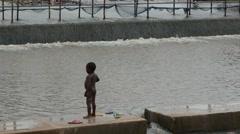 Africa Ghana kid river shower 4K Stock Footage