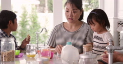 Mother Helping Children With Breakfast Shot On R3D Stock Footage