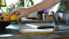 Man washes lemons and cut them Stock Footage