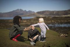 Mother showing son rock, Isle of Skye, Hebrides, Scotland - stock photo