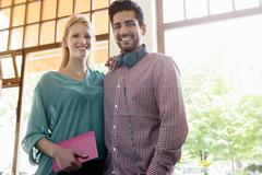 Portrait of young couple in cafe - stock photo