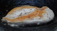 Chicken breast fried in a cast-iron pan Stock Footage