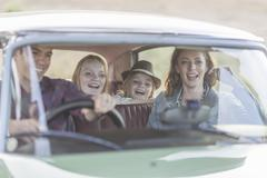 Family in car together, taking road trip Stock Photos