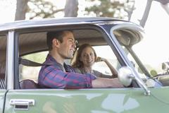 Heterosexual couple in car together, smiling Stock Photos