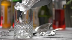 Ice slowly falling into jug. - stock footage