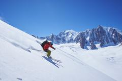 Male skier speeding downhill,  Mont Blanc massif, Graian Alps, France - stock photo