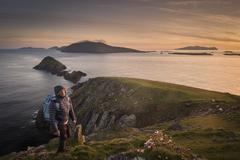 Mid adult man, hiking, Slea head, County Kerry, Ireland - stock photo