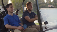 Golfers Driving Buggy Along Golf Course In Slow Motion Stock Footage