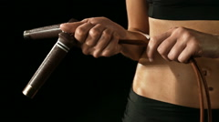 Young athletic woman wearing sporstwear with skipping rope slow motion Stock Footage