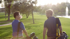 Slow Motion Shot Of Male Golfers Walking Along Fairway Arkistovideo
