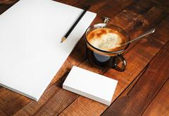 Blank letterhead, coffee cup and pencil Stock Photos
