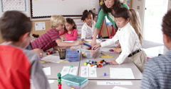 Teacher and young kids use blocks in class, shot on R3D Stock Footage