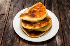 Karelian pastries -keitinpiiroa. Pies for the son-in-law with millet gruel Stock Photos