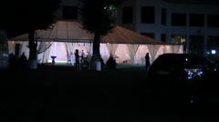 A medium shot of a large tent wedding reception Stock Footage