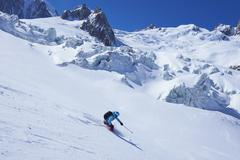 Mature female skier moving downhill on Mont Blanc massif, Graian Alps, France - stock photo