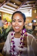 Portrait of young woman wearing flower lei in Polynesian Cultural Centre, - stock photo