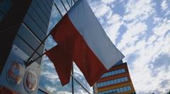 Waving Polish Flags on Building Stock Footage