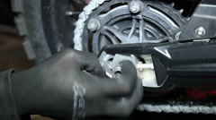 Mechanical tightening nut on the motorcycle behind wheel Stock Footage