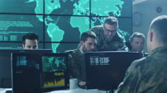 Group of Military IT Professionals on Briefing in Monitoring Room Stock Footage