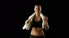 Young athletic woman wearing sporstwear is drying with white towel Stock Footage