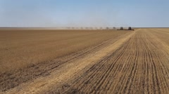 Many harvesters. Wheat harvest. The plane flies over a field Stock Footage