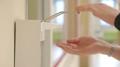 Hands sterilization at patient room in a modern hospital using soap dispenser Stock Footage