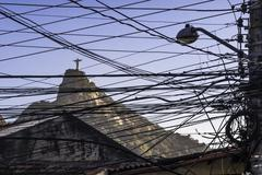 View of Christ the Redeemer statue through telegraph wires and cables, Rio De Stock Photos