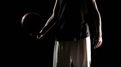 Young athletic sportsman perform basketball freestyle trick Stock Footage