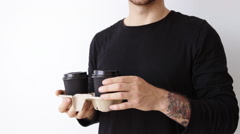 Handsome man with take away cup slow motion action commercial footage - stock footage