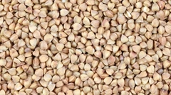 Buckwheat close up. Front of the camera rotates plate with buckwheat - stock footage