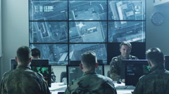 Group of Military IT Professionals in Monitoring Room on Military Base - stock footage