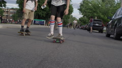 Close up of young man pushing skateboard on street Stock Footage