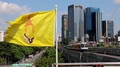 Train arriving at the station with fluttering flag of the Kingdom of Thailand Stock Footage