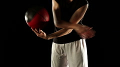 Young athletic sportsman perform basketball freestyle trick - stock footage