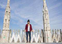 Woman standing on roof of Duomo Cathedral, Milan, Italy - stock photo